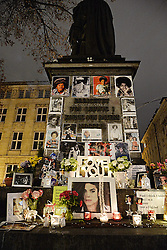 Image ©Licensed to i-Images Picture Agency. 03/12/2014. Munich, Germany. A memorial for Michael Jackson at the Promenadeplatz in front of the Hotel Bayerischen Hof in Munich. Fans have transformed the monument of Orlando di Lasso in honour of The King of Pop . Michael Jackson was a guest in March 1998 at the Bayerischer Hof. Day by day this place is visited by his fans. Picture by Face to Face / i-Images<br /> UK ONLY