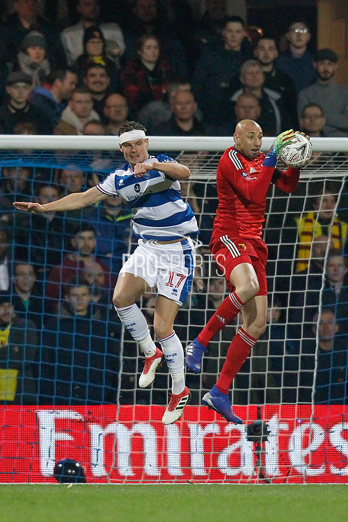 Watford goalkeeper Heurelho Gomes (1) and Queens Park Rangers forward Matt Smith (17) during The FA Cup 5th round match between Queens Park Rangers and Watford at the Loftus Road Stadium, London, England on 15 February 2019.
