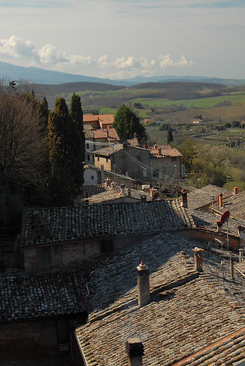 Tops of terracotta tiles roofs in Tuscany