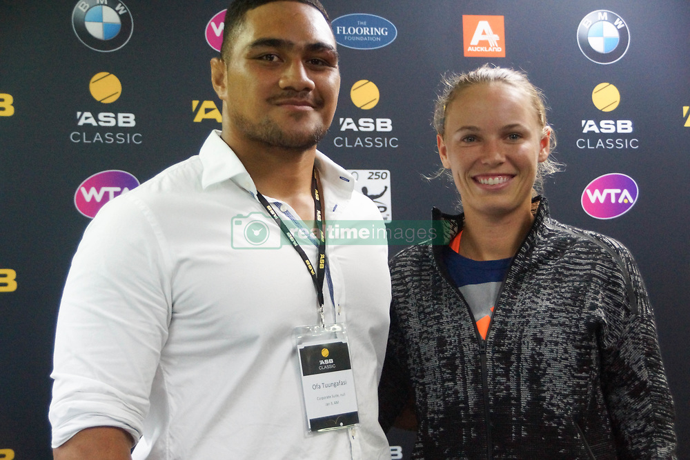 January 3, 2018 - Auckland, Auckland, New Zealand - Caroline Wozniacki of Denmark and New Zealand All Blacks Ofa Tu'ungafasi pose for photo after winning  her match against Petra Martic of  Croatia during Day Three of the WTA Women's Tournament at ASB Centre Count in Auckland, New Zealand on Jan 3, 2018. The world No 3 cruises into the quarterfinals with a 6-2 6-2 win over Petra Martic  (Credit Image: © Shirley Kwok/Pacific Press via ZUMA Wire)