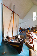 Historic viking longboat with traditional sails among exhibits at Viking Museum heritage centre in Ribe in South Jutland, Denmark