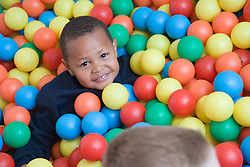 Boy playing in the ball pit at an early start nursery; ran by the Nottingham Royal Society for the Blind (NRSB),