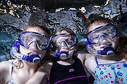 Three girls in snorkels underwater