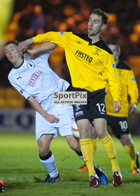 Rory Boulding (12) tussles with Dale Fulton, Livingston v Falkirk, SFL Division 1, Braidwood Motor Company Stadium, Monday 2nd January 2012