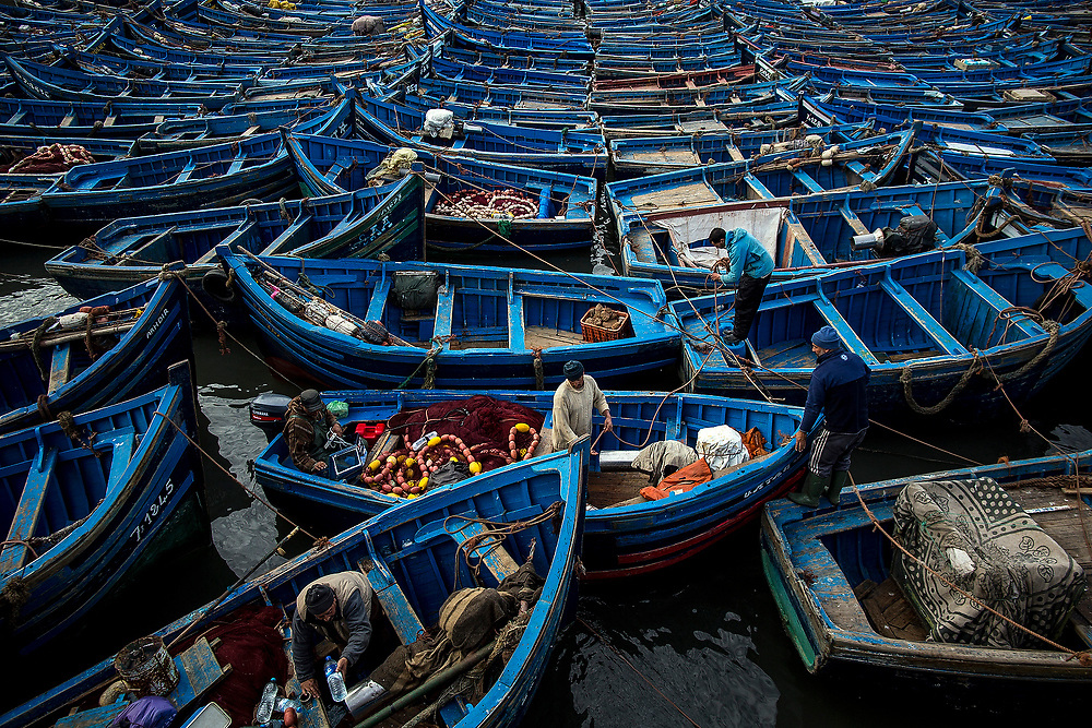 ESSAOUIRA, MOROCCO - DECEMBER 6, 2015: <br /> Wooden fishing boats on the Port of Essaouira.<br /> <br /> Morocco is not only desert. The country is developing and King Mohammed VI announced a strategy to lure 10 million annual visitors to Morocco que Involved Improving infrastructure and highlighting key regions for development. One of the areas that has been growing is its coast. Along the hundreds of miles from the coast we can find small towns where the beaches, people, markets make this place a magical place.