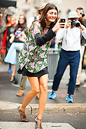 Giovanna Battaglia Taking a Photo at Dolce & Gabbana
