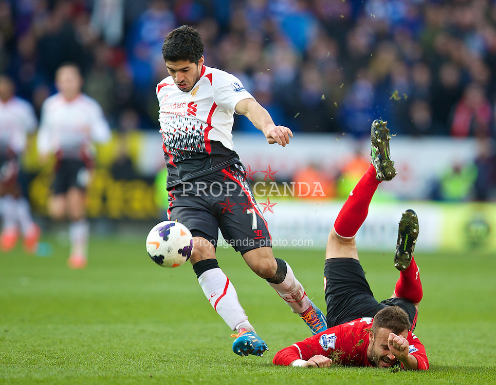 CARDIFF, WALES - Saturday, March 22, 2014: Liverpool's Luis Suarez wins the ball from Cardiff City's Juan Torres Ruiz Cala before going on to score his hat-trick goal, Liverpool's sixth, during the Premiership match at the Cardiff City Stadium. (Pic by David Rawcliffe/Propaganda)