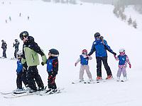 Children learning skiing at Blue Mountain, Collingwood, Ontario, Canada alpine ski resort.