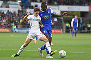 Swansea City midfielder Daniel James (20) and Ipswich Town defender Aristote Nsiala (22) battle for the ball during the EFL Sky Bet Championship match between Swansea City and Ipswich Town at the Liberty Stadium, Swansea, Wales on 6 October 2018.