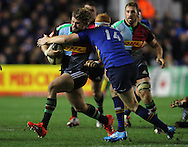 Luke Wallace of Harlequins is tackled by Darragh Fanning of Leinster during the European Rugby Champions Cup match at Twickenham Stoop , London<br /> Picture by Paul Terry/Focus Images Ltd +44 7545 642257<br /> 07/12/2014
