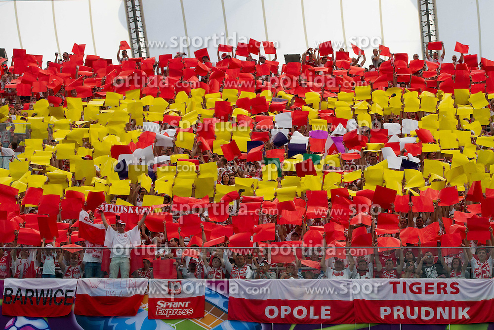 Spanish flag made by fans during Opening ceremony prior to the UEFA EURO 2012 group A match between Poland and Greece at The National Stadium on June 8, 2012 in Warsaw, Poland.  (Photo by Vid Ponikvar / Sportida.com)