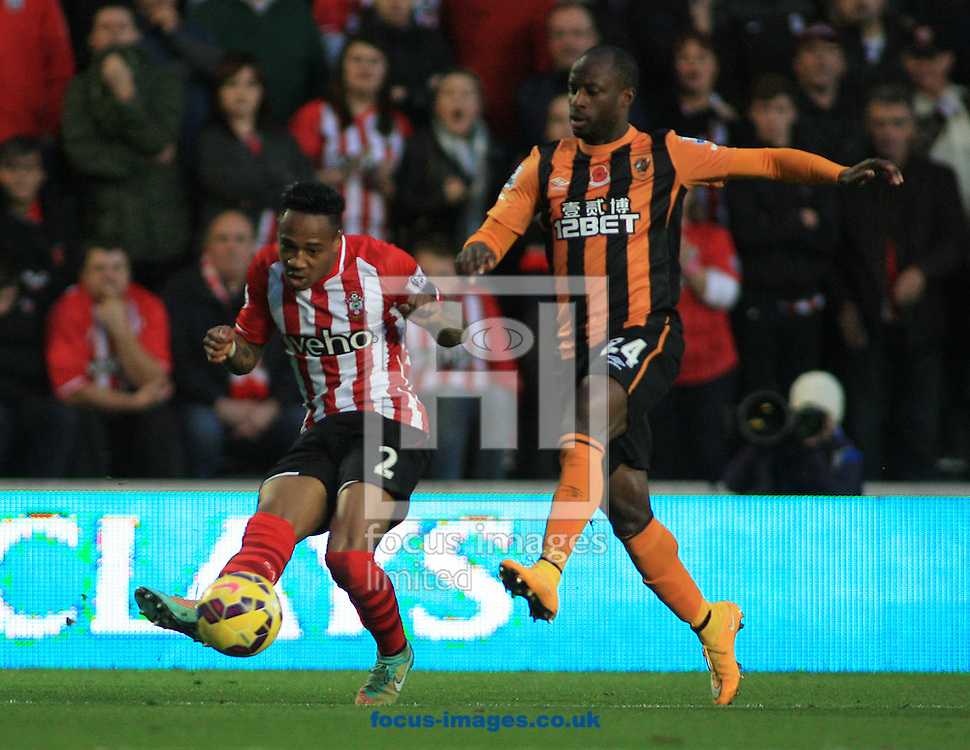 Sone Aluko (right) of Hull City attempts to block the cross from Nathaniel Clyne of Southampton during the Barclays Premier League match at KC Stadium, Hull<br /> Picture by Richard Gould/Focus Images Ltd +44 7855 403186<br /> 01/11/2014