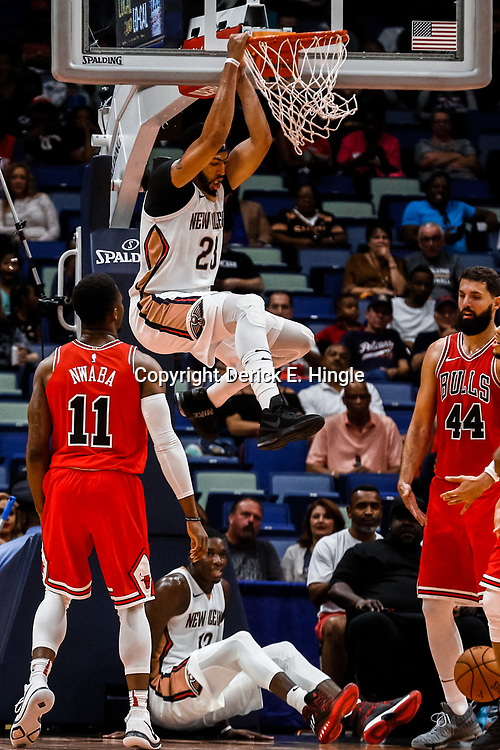 Oct 3, 2017; New Orleans, LA, USA; New Orleans Pelicans forward Anthony Davis (23) dunks over Chicago Bulls guard David Nwaba (11) and forward Nikola Mirotic (44) during the first quarter of a NBA preseason game at the Smoothie King Center. Mandatory Credit: Derick E. Hingle-USA TODAY Sports