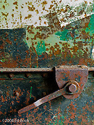 Rusty metal door with metal lever handle at Fort Worden, constructed in the   late 1800's to protect Puget Sound from enemy ships.  Fort Worden is located at Point Wilson on Admiralty Inlet, Port Townsend, Washington, USA