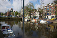 View of a large canal in Amsterdam.