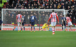 Stoke City's Charlie Adam shot takes a deflection from Manchester United's Michael Carrick to go into the net. - Photo mandatory by-line: Alex James/JMP - Tel: Mobile: 07966 386802 01/02/2014 - SPORT - FOOTBALL - Britannia Stadium - Stoke-On-Trent - Stoke v Manchester United - Barclays Premier League
