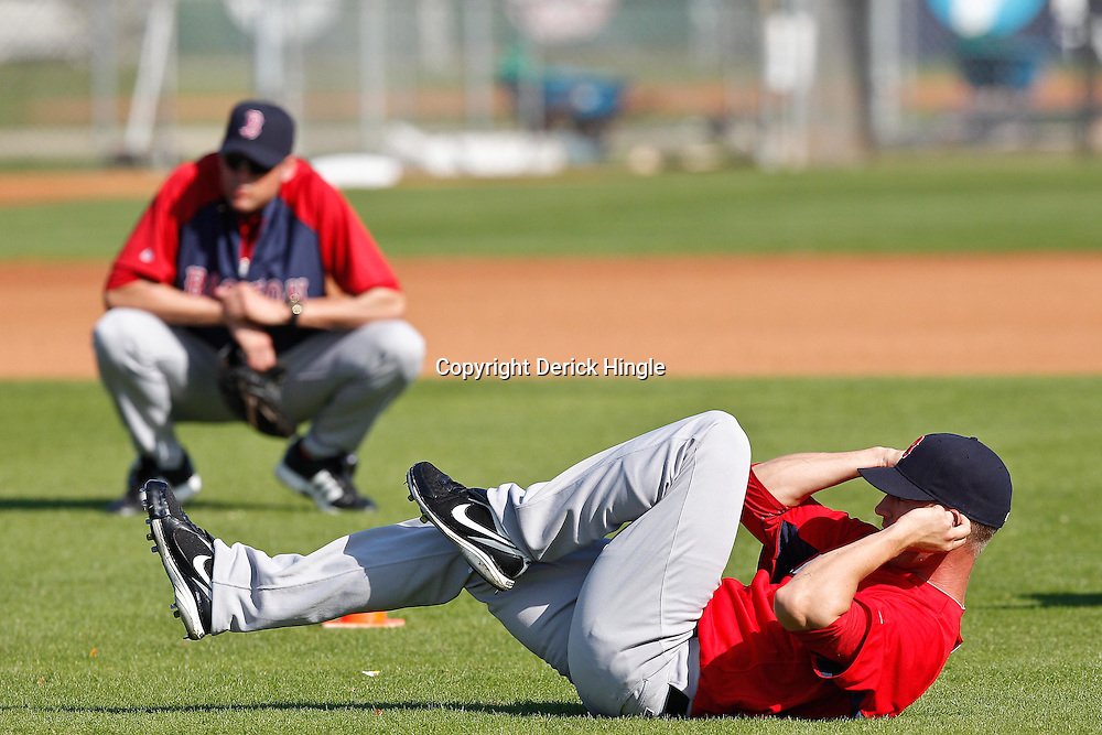 February 18, 2011; Fort Myers, FL, USA; Boston Red Sox pitcher Matt Fox stretches during spring training at the Player Development Complex.  Mandatory Credit: Derick E. Hingle