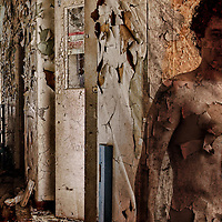 A derelict hallway with a naked man