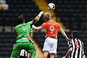 Notts County goalkeeper Adam Collin (1) with Blackpool forward Mark Cullen (9) attempting to head the ball during the EFL Sky Bet League 2 match between Notts County and Blackpool at Meadow Lane, Nottingham, England on 29 April 2017. Photo by Jon Hobley.
