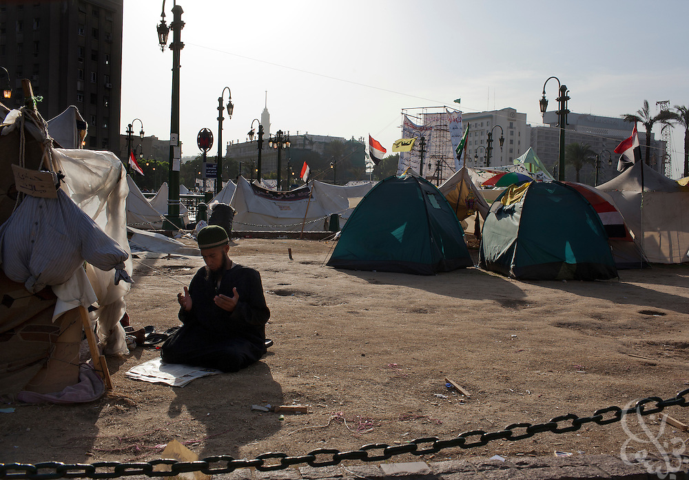 An Egyptian man prays outside his tent in Tahrir Square in Cairo, Egypt July 27,2011. Nearly six months after the Jan 25 revolution, many activists, families of martyrs and victims occupying the square are still struggling to obtain justice and continue with the goals they set out to achieve. (Photo by Scott Nelson for Stern)