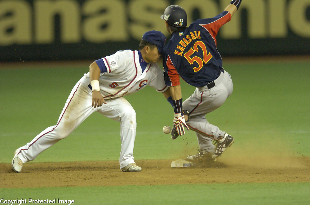 Team Japan's Munenori Kawasaki steals second base in the 6th inning against Team Chinese Taipei in Game 4 of the World Baseball Classic at Tokyo Dome, Tokyo, Japan.