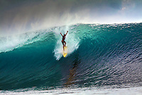 Surfing a huge wave in the Mentawai Islands, Indonesia