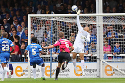 Peterborough United's Bobby Olejnik makes a diving save  - Photo mandatory by-line: Joe Dent/JMP - Tel: Mobile: 07966 386802 17/08/2013 - SPORT - FOOTBALL - London Road Stadium - Peterborough -  Peterborough United V Oldham Athletic - Sky Bet League One