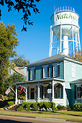 American scene - water tower looms above a typical house in Natchez, Mississippi, USA