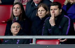 Tottenham Hotspur manager Mauricio Pochettino (right) appears dejected in the stands at the end of the Premier League match at St Mary's Stadium, Southampton.
