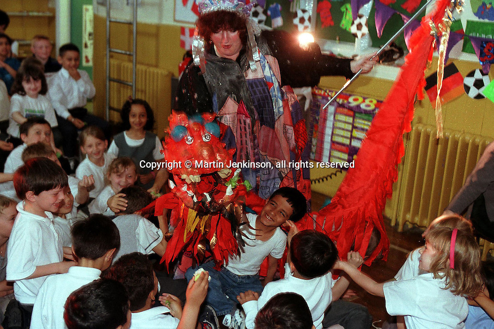 Pupils at a primary school feed the Chinese New Year dragons during a multicultural show  part of Bradford Festival....© Martin Jenkinson tel 0114 258 6808  mobile 07831 189363 email martin@pressphotos.co.uk  NUJ recommended terms & conditions apply. Copyright Designs & Patents Act 1988. Moral rights asserted credit required. No part of this photo to be stored, reproduced, manipulated or transmitted by any means without prior written permission.
