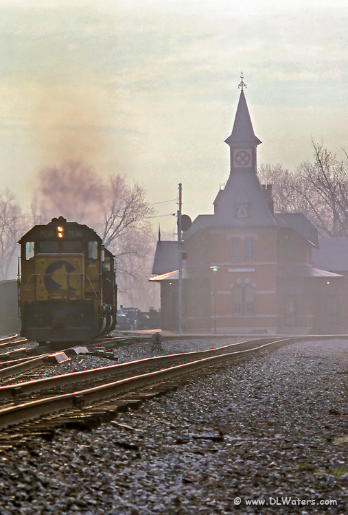 I set up the camera and tripod to take a shot of the caboose as the train was passing. It had a pusher engine instead which worked out even better.