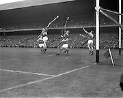 01/09/1968<br /> 09/01/1968<br /> 1 September 1968<br /> All-Ireland Senior Hurling Final: Tipperary v Wexford at Croke Park, Dublin. <br /> J. Doyle (Tipperary) sends a fast ball in past a strong Wexford defence to record the first goal of the match.