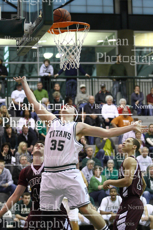 15 December 2012:  Andrew Ziemnik watches his shot during an NCAA mens division 3 basketball game between theUniversity of Chicago Maroons and the Illinois Wesleyan Titans in Shirk Center, Bloomington IL