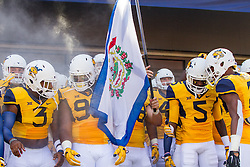 Sep 3, 2016; Morgantown, WV, USA; The West Virginia Mountaineers run onto the field before their game against the Missouri Tigers at Milan Puskar Stadium. Mandatory Credit: Ben Queen-USA TODAY Sports