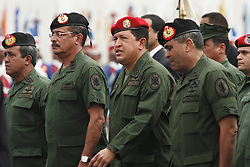 President Hugo Chavez  participates in a military parade at the Fuerte Tiuna military base