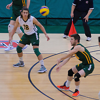 1st year libero Dryden Wall (18) of the Regina Cougars and 1st year Setter Noah Young (6) of the Regina Cougars in action during the Men's Volleyball Home Game vs Trinity Western  on October 28 at the CKHS University of Regina. Credit Matt Johnson/Arthur Images