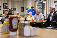 Vice President Joe Biden, second from right, and Agriculture Secretary Tom Vilsack, right, talk with patrons during an unannounced stop at the Good Earth Restaurant during a two-day campaign swing through Iowa on Monday, September 17, 2012 in Muscatine, IA.