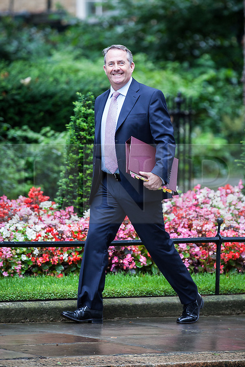 © Licensed to London News Pictures. 02/08/2016. London, UK. Secretary of State for International Trade Liam Fox arrives on Downing Street for a meeting of the Cabinet Committee on Economy and Industrial Strategy. Photo credit: Rob Pinney/LNP
