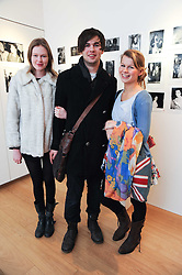 Left to right, FAYE YOUNG, ALEX CALKIN and CLEMENCY CALKIN at a private view of photographs by Nick Ashley held at the Sladmore Gallery, 32 Bruton Place, London on 13th January 2010.