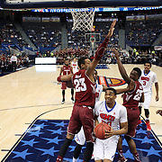 Ben Moore, (center), SMU, prepares to shoot while defended by Devontae Watson, (left) and Quenton DeCosey, Temple, during the Temple Vs SMU Semi Final game at the American Athletic Conference Men's College Basketball Championships 2015 at the XL Center, Hartford, Connecticut, USA. 14th March 2015. Photo Tim Clayton