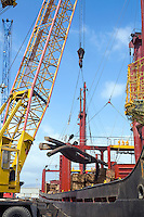 Limassol Cyprus. Dockside crane unloading steel rods from a freighter