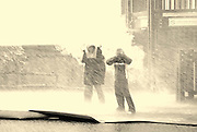Israel, Tel Aviv, Two people standing in a downpour of rain