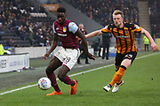 Aston Villa defender Axel Tuanzebe (28) beats Hull City defender Max Clark (24)  during the EFL Sky Bet Championship match between Hull City and Aston Villa at the KCOM Stadium, Kingston upon Hull, England on 31 March 2018. Picture by Mick Atkins.