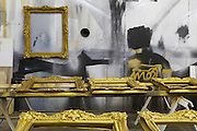 Gold painted frames set out to dry at McWood design/build shop.
