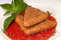 Plate of fried mozzarella with marinara sauce and parsley.