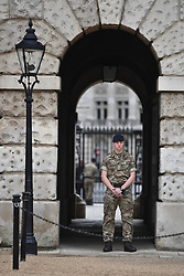 © Licensed to London News Pictures. 16/09/2017. London, UK. A soldier watches guard in Westminster,  London at a location normally guarded by armed police, the day after a bomb partly exploded on a tube train at Parsons Green station in London injuring members of the public. Operation temperer has been put in to place after the UK terror threat level was raised to critical. Photo credit: Ben Cawthra/LNP