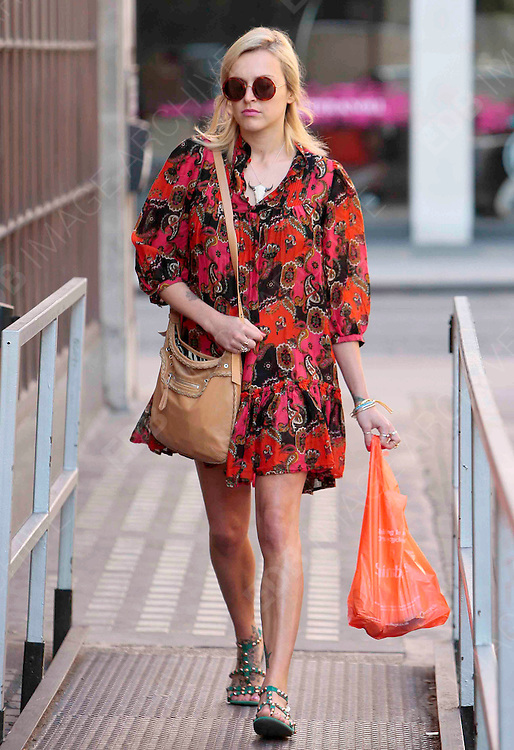 18.JULY.2012. LONDON<br /> <br /> FEARNE COTTON ARRIVING AT RADIO ONE, LONDON<br /> <br /> BYLINE: EDBIMAGEARCHIVE.CO.UK<br /> <br /> *THIS IMAGE IS STRICTLY FOR UK NEWSPAPERS AND MAGAZINES ONLY*<br /> *FOR WORLD WIDE SALES AND WEB USE PLEASE CONTACT EDBIMAGEARCHIVE - 0208 954 5968*