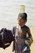 Young African boy at the lake
