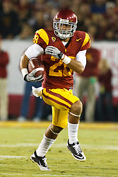 September 11, 2010; Los Angeles, CA, USA;  Southern California Trojans running back Dillon Baxter (28) rushes up field against the Virginia Cavaliers during the second quarter at the Los Angeles Memorial Coliseum. USC defeated Virginia 17-14.