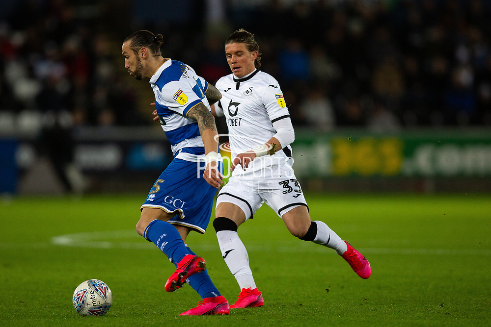 Queens Park Rangers defender Geoff Cameron (5) is challenged by Swansea City midfielder Conor Gallagher (33) during the EFL Sky Bet Championship match between Swansea City and Queens Park Rangers at the Liberty Stadium, Swansea, Wales on 11 February 2020.